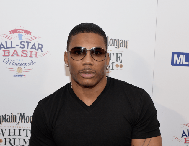 Nelly posing on a red carpet.