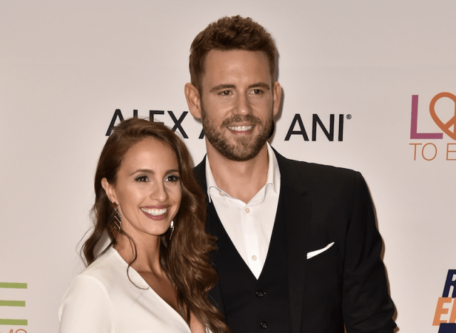Nick Viall and Vaness Grimaldi smiling on a red carpet.
