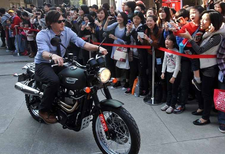 Norman Reedus rides a motorcycle