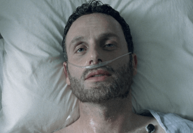 Rick lying in a hospital bed.