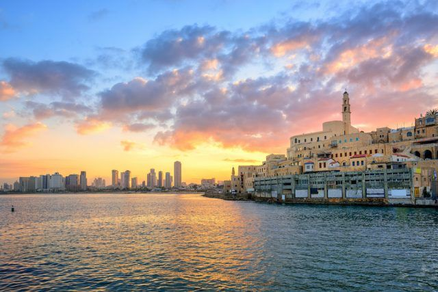 Old town of Jaffa and the modern skyline of Tel Aviv city on sunrise, Israel