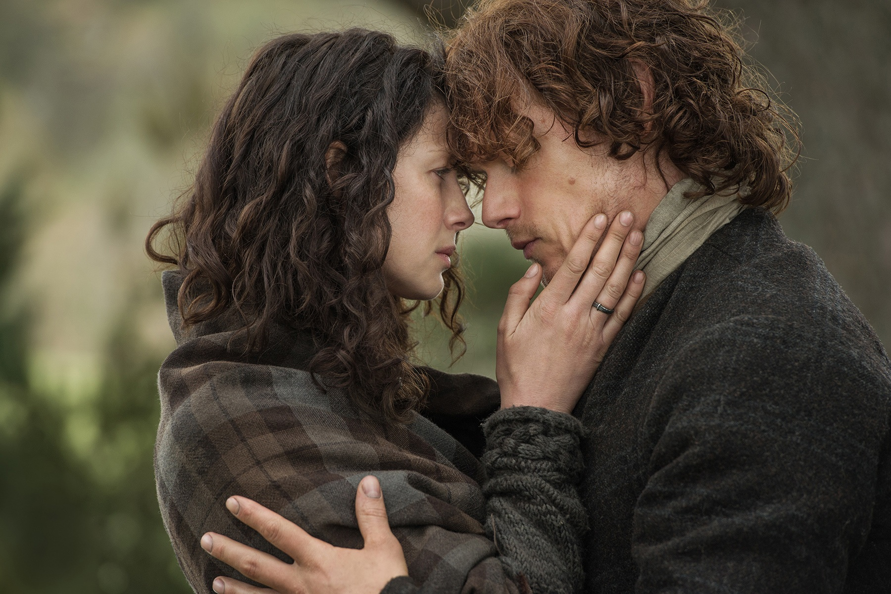 Jamie and Claire embrace on Outlander