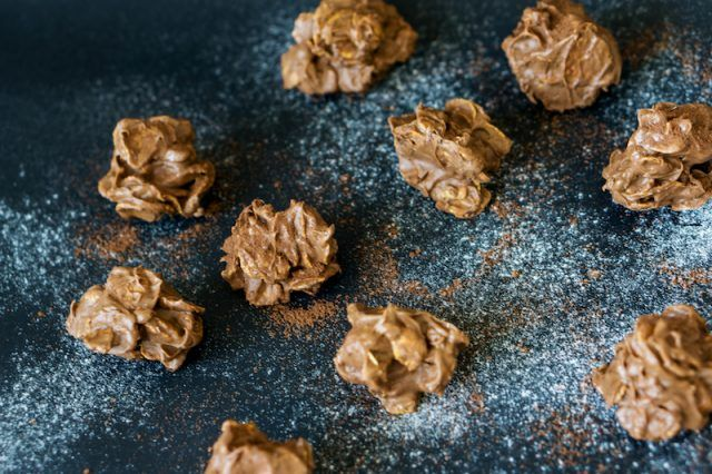 Pralines on a powdered surface.