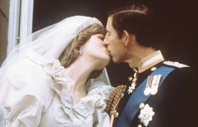 Princess Diana and Prince Charles kiss on their wedding day.