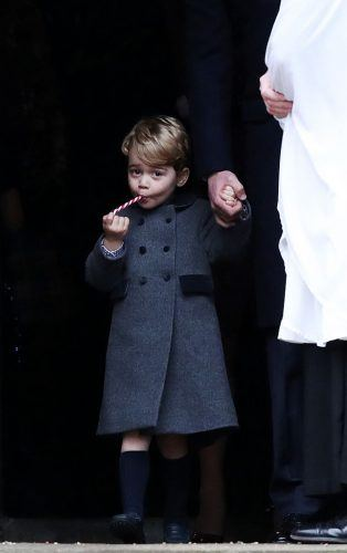 Prince George of Cambridge eats a sweet as he leave following the service at St Mark's Church on Christmas Day on December 25, 2016 in Bucklebury, Berkshire. (Photo by Andrew Matthews - WPA Pool/Getty Images)