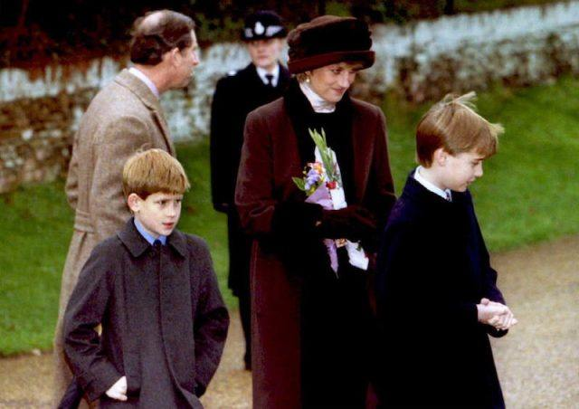 Princess Diana walking with her two sons and husband.