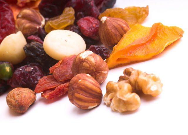 Dried fruit on a white table.