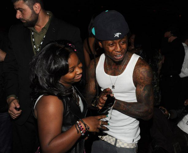 Lil Wayne and his daughter at a concert.