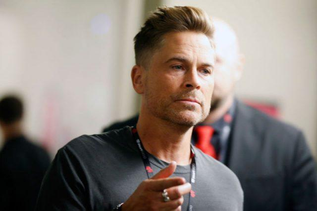 Rob Lowe pointing his index finger.