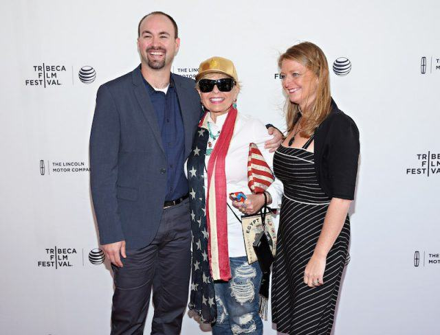 Roseanne Barr posing with her two children at a film festival.