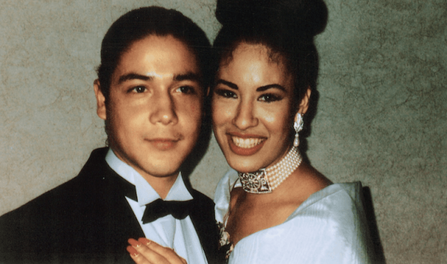 Selena and Chris Perez posing together and smiling.