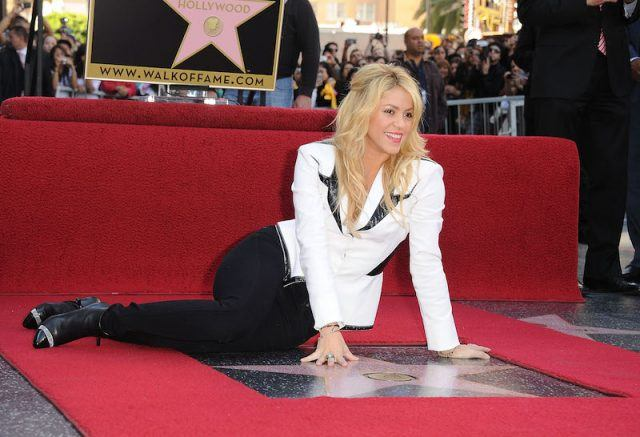 Shakira smiles and poses with her star.