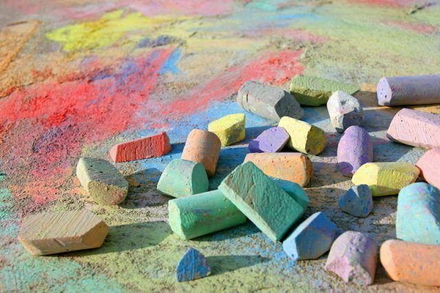 Colorful chalk on a sidewalk.