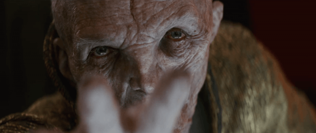 Snoke focusing two fingers in front of him as he looks straight forward.