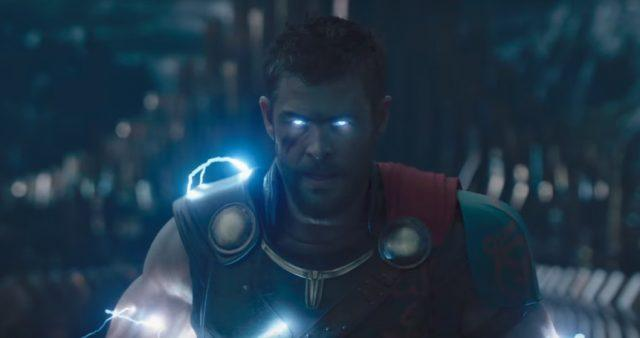 Thor with electricity flowing over his body and illuminating his eyes.