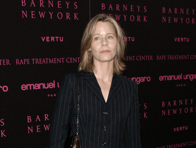 Susan Dey posing for photos on a red carpet.