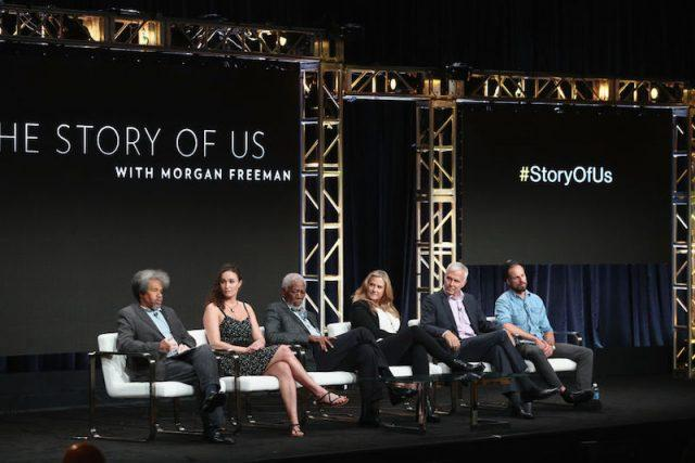 Morgan Freeman sits with the cast of 'The Story of Us' on a white couch on stage during a panel.