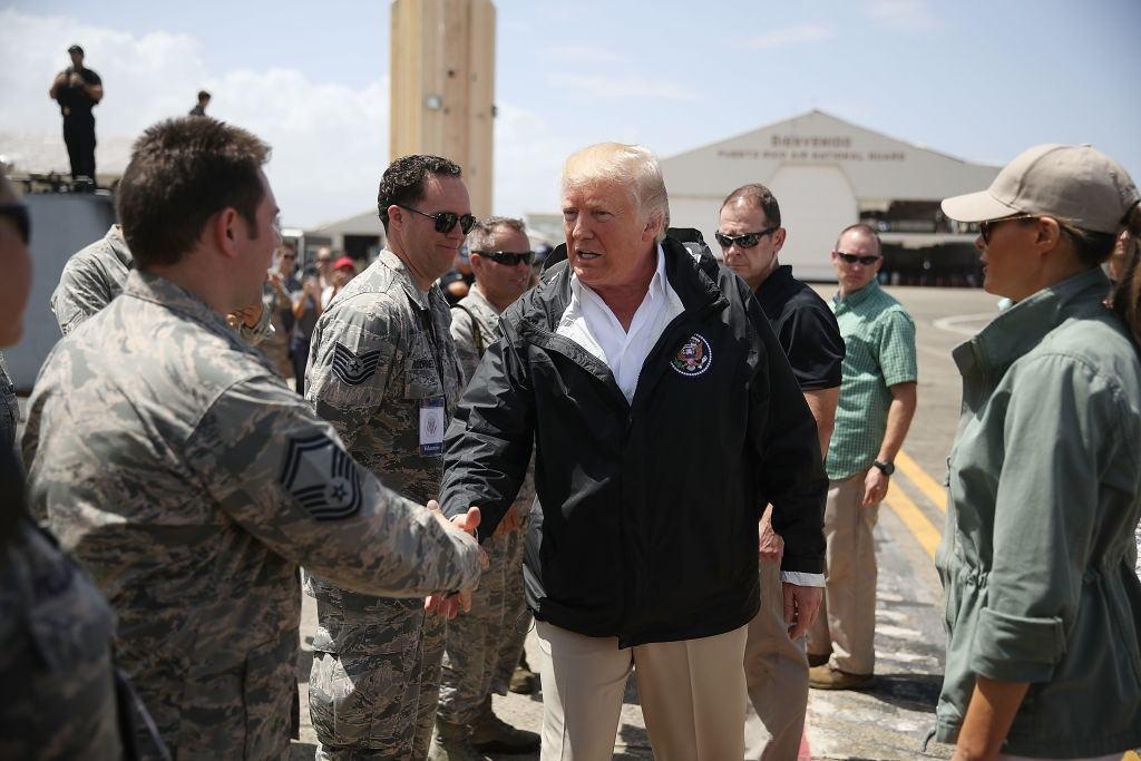 President Donald Trump greets U.S Air Force airmen