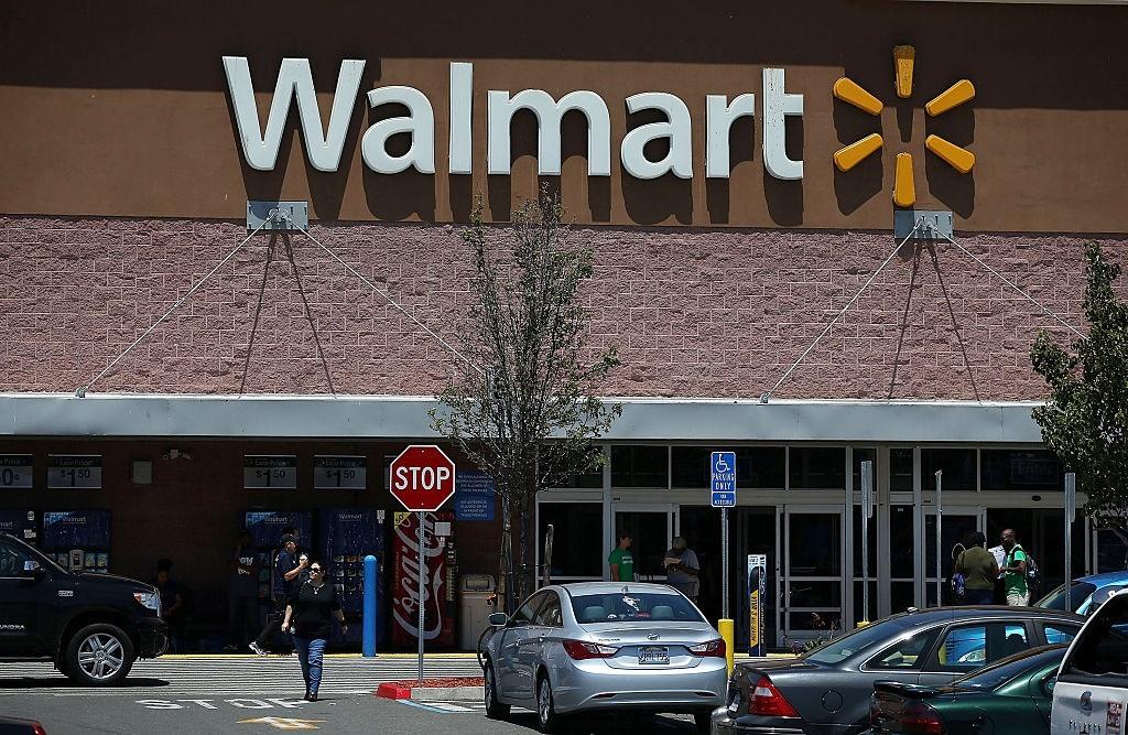 Customers leave a Walmart store