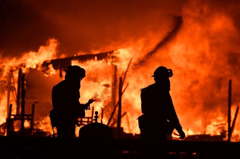 Firefighters douse flames as a home burns