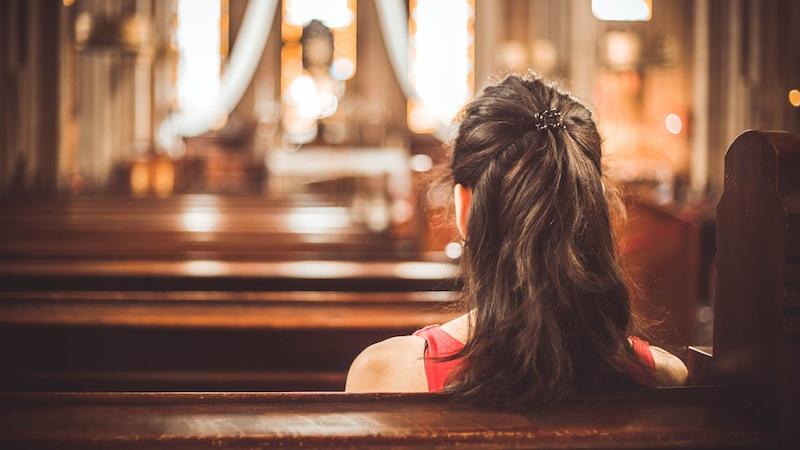 A woman sitting in a Christian church