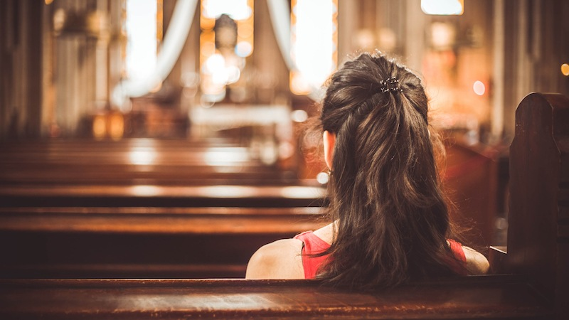 A woman sitting in a Christian church