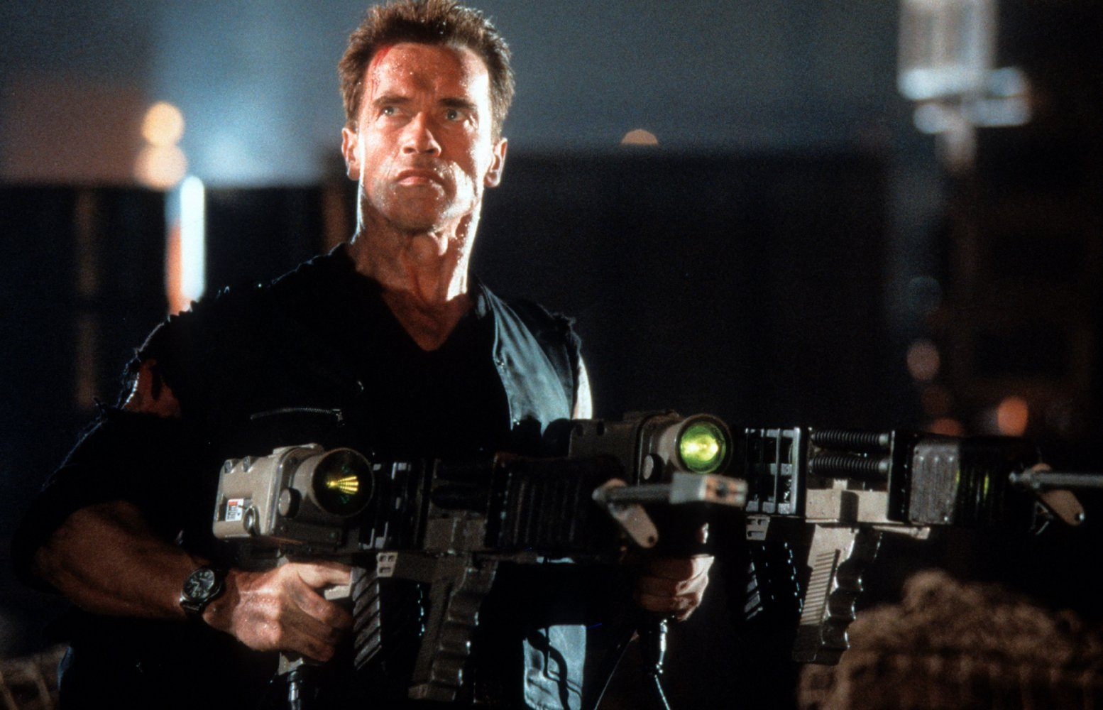 Arnold Schwarzenegger holds a weapon in Eraser