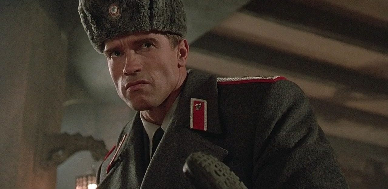 Arnold Schwarzenegger wears a uniform and hat in Red Heat