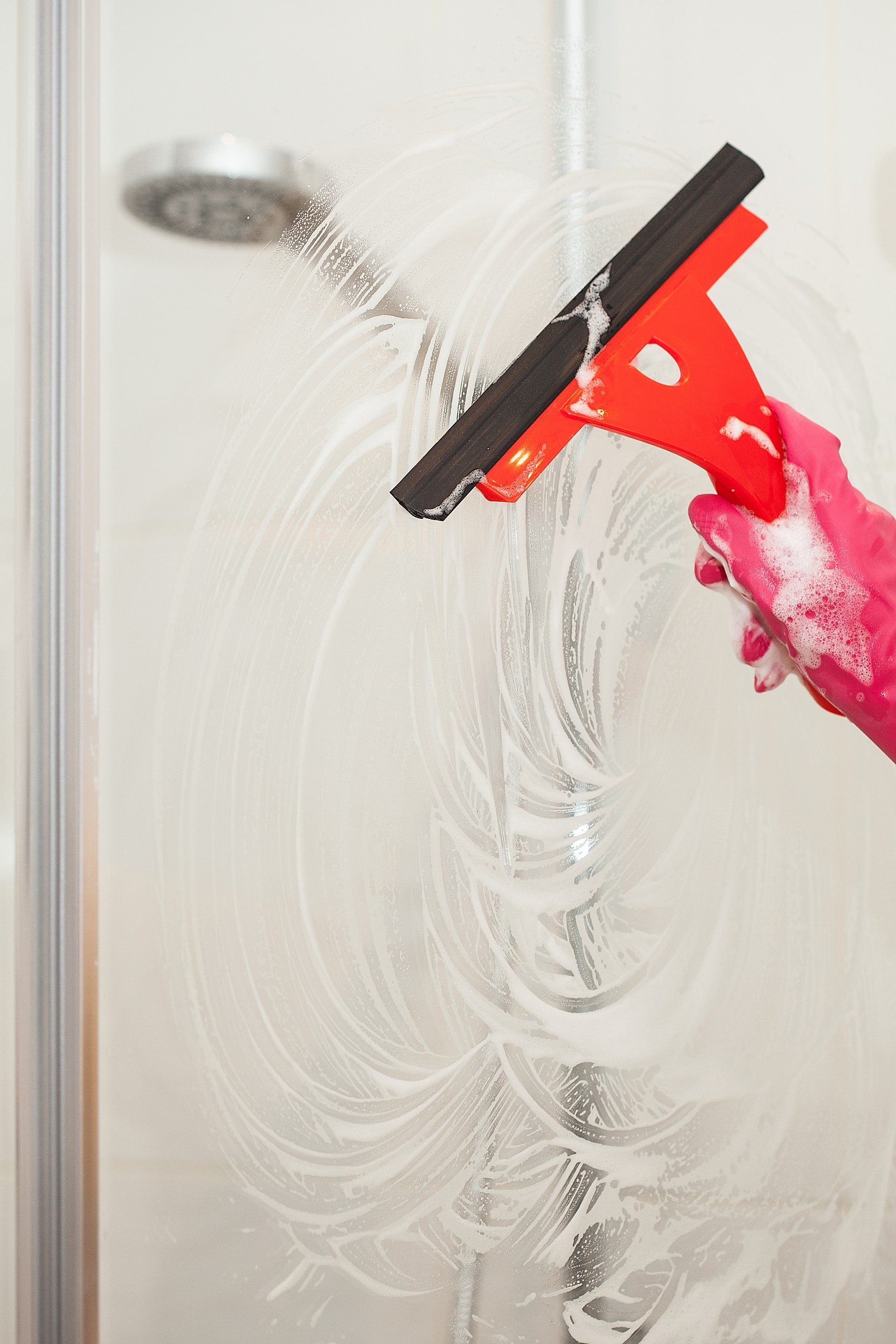 Shower cleaning with squeegee