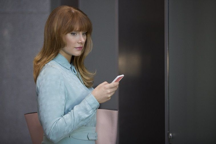 Bryce Dallas Howard holds a phone and wears a blue jacket on Black Mirror