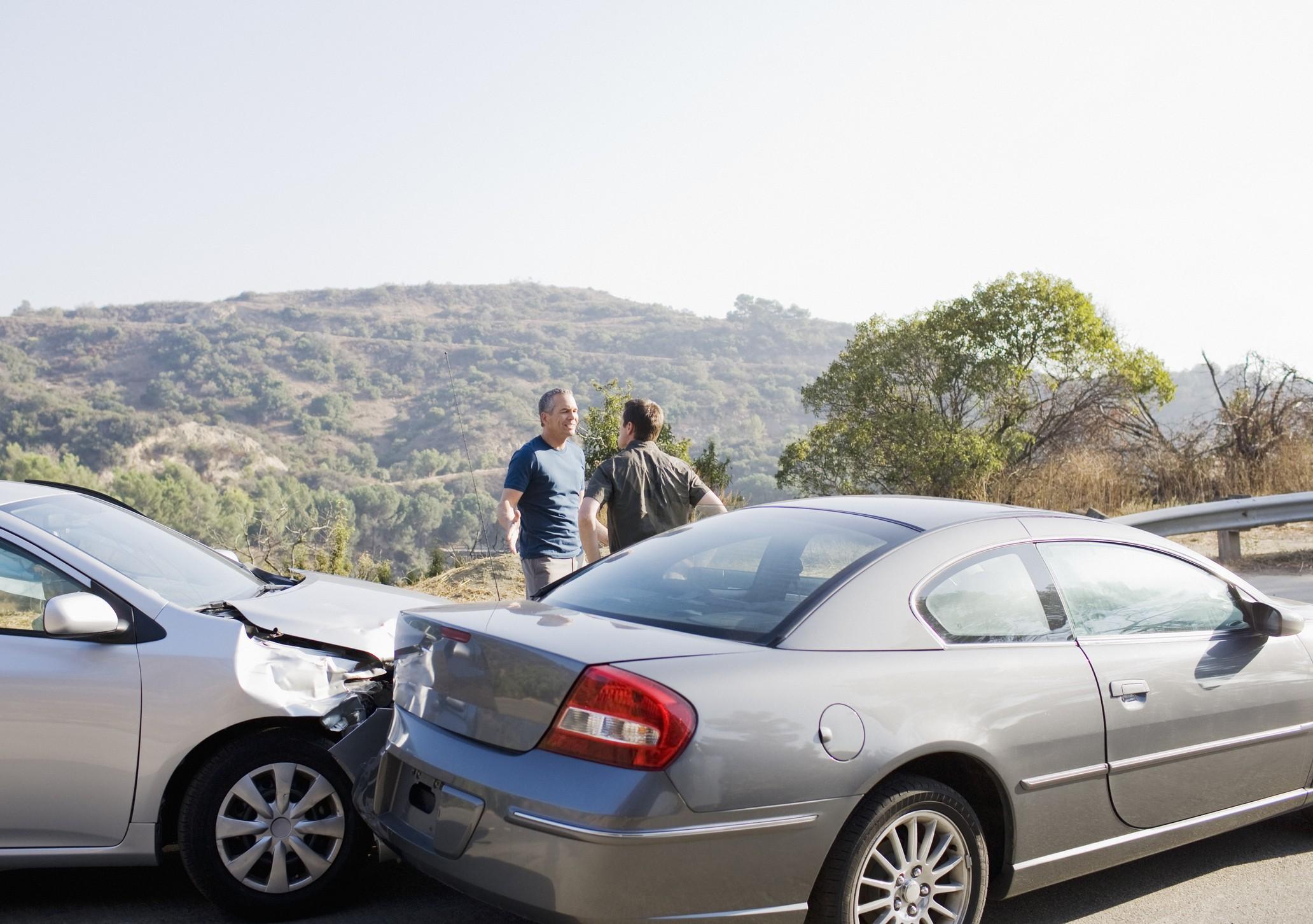 Men arguing car crash