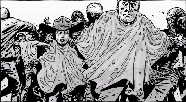 Wearing ponchos, Carl and Rick Grimes try to evade walkers in 'The Walking Dead' comics.
