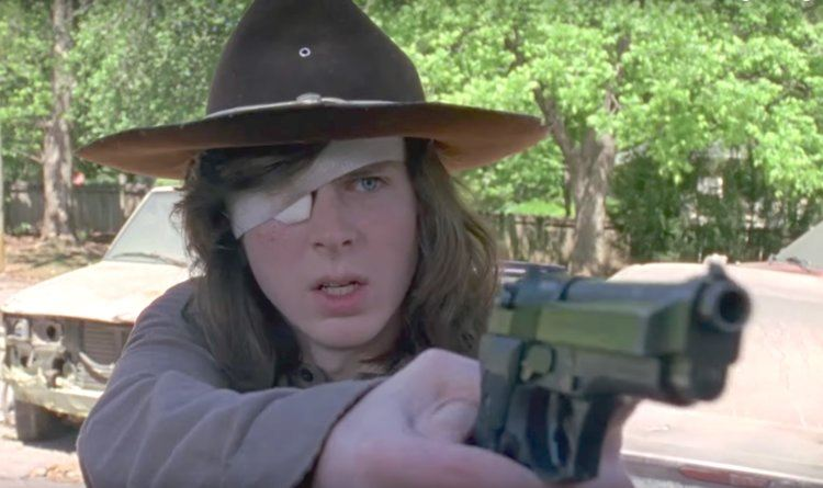 "Carl in The Walking Dead Season 8 episode ""Mercy"" holding a gun."