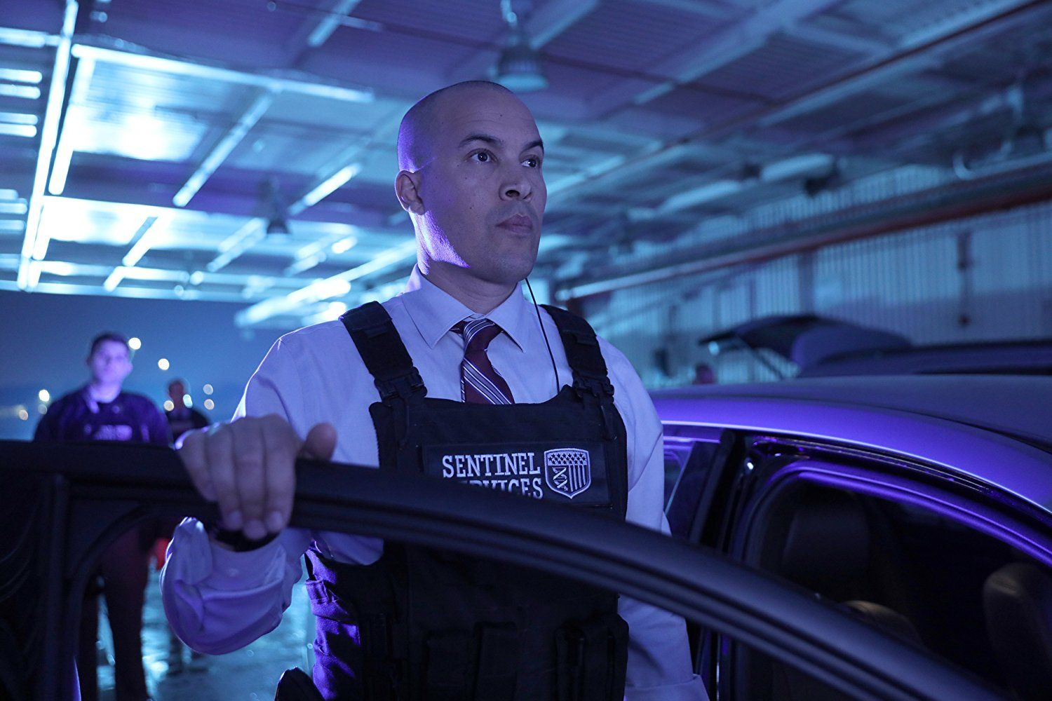 Coby Bell as Jace Turner in a uniform getting out of a car