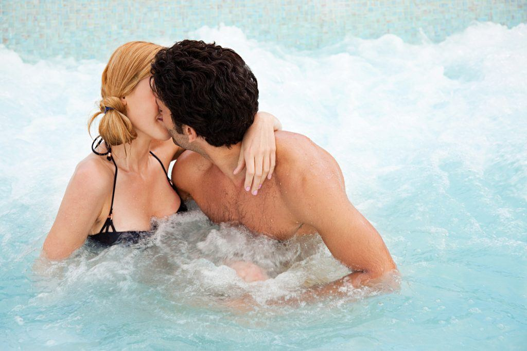 Couple kissing in hot tub
