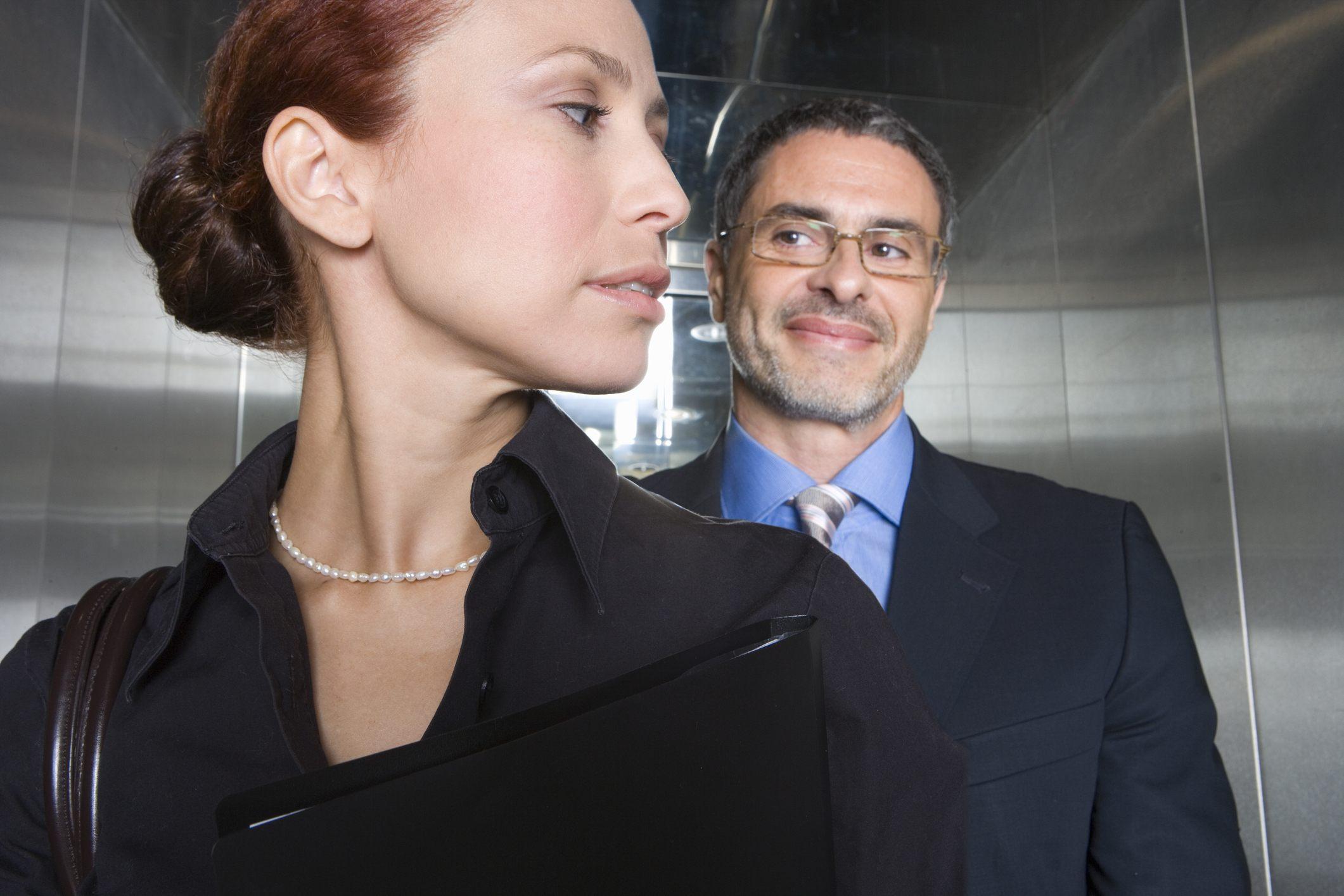 Creepy business man in elevator