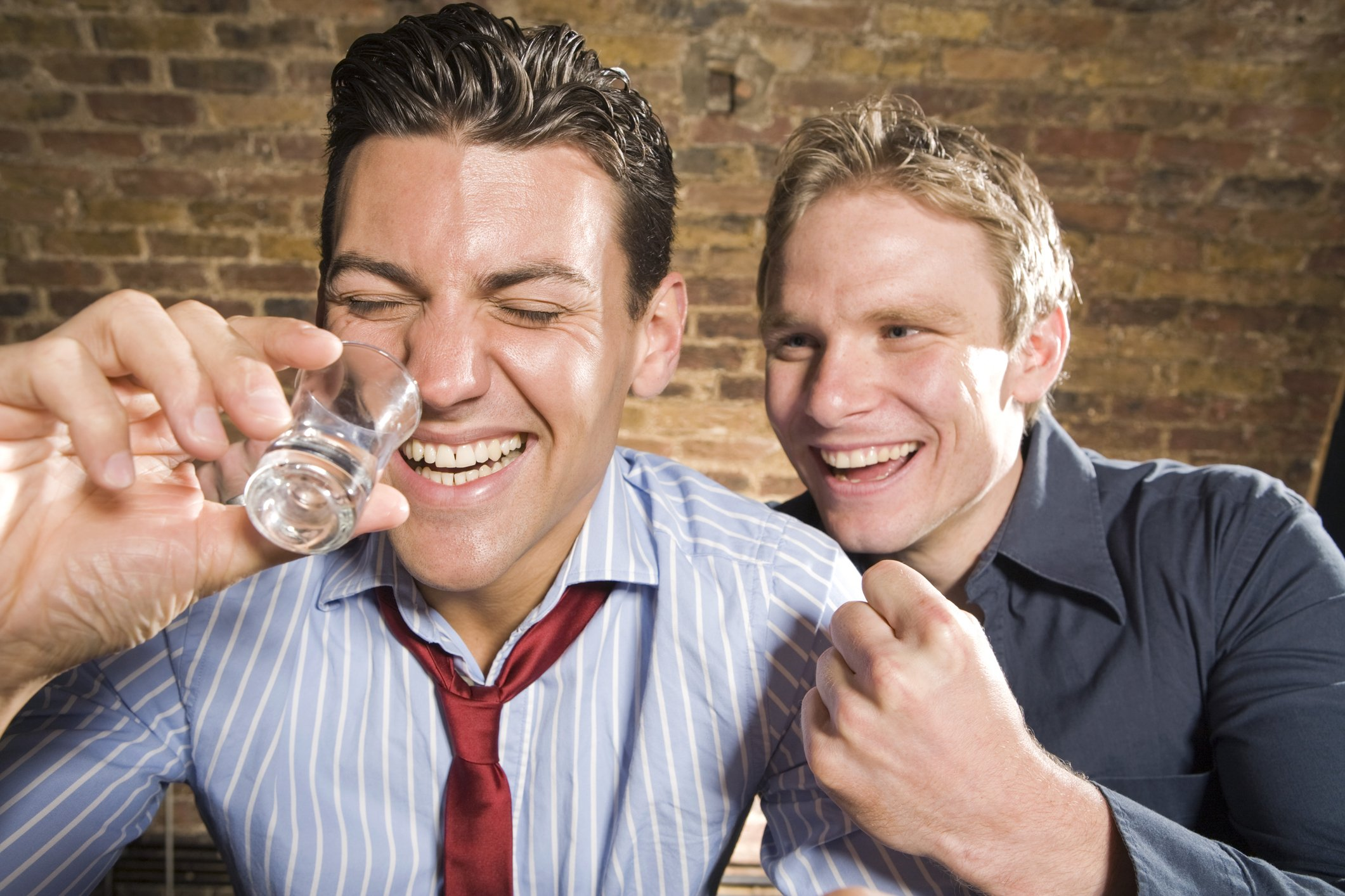 Drunk guys at a bar