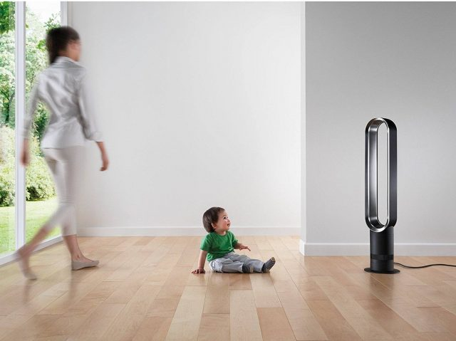 Woman and toddler by air purifier