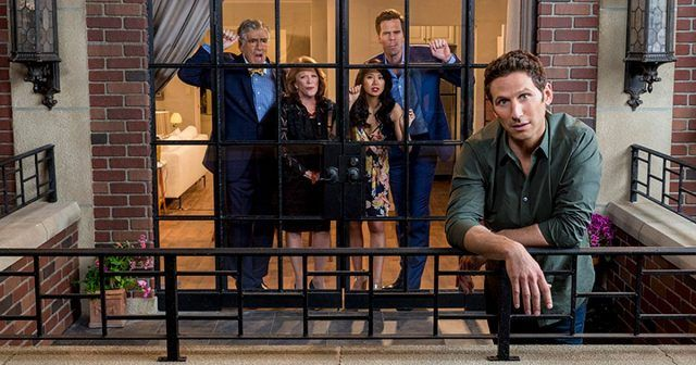 The cast if '9JKL' staring out a window.