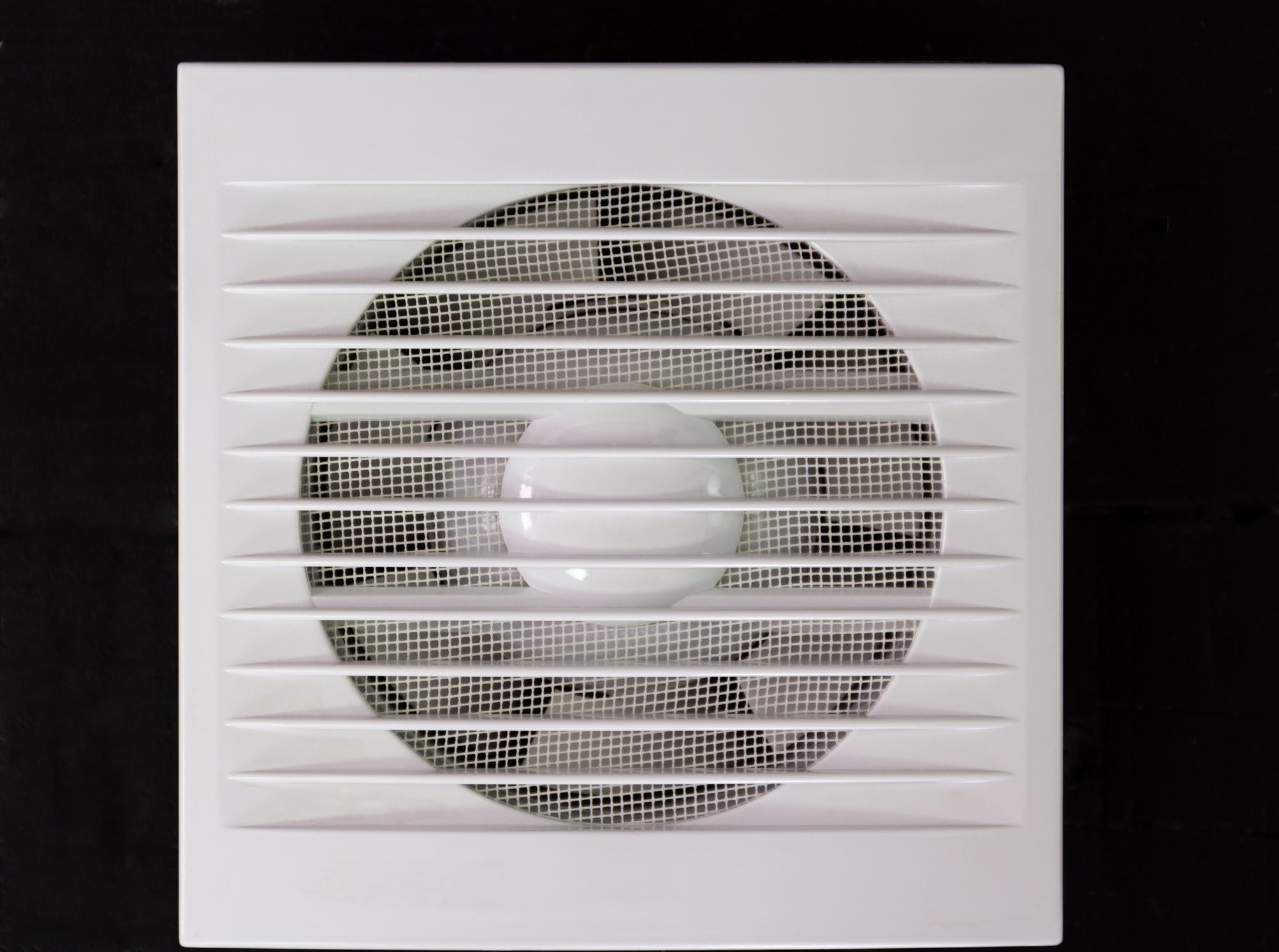 Wall electric extractor fan for bathroom. Closeup