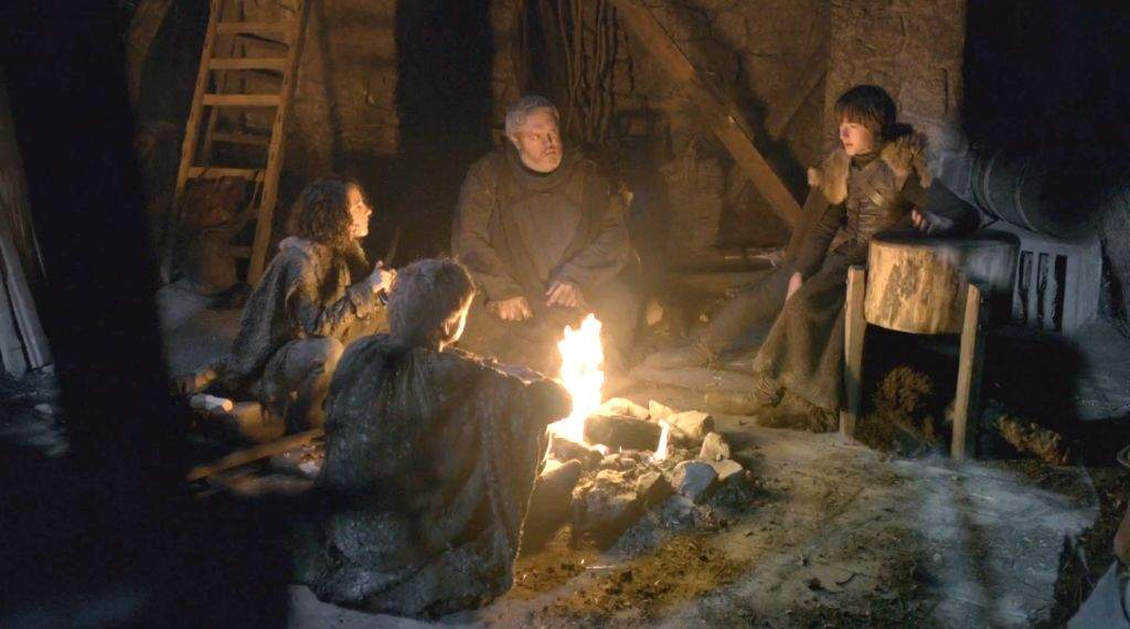 People sitting around a campfire on Game of Thrones.