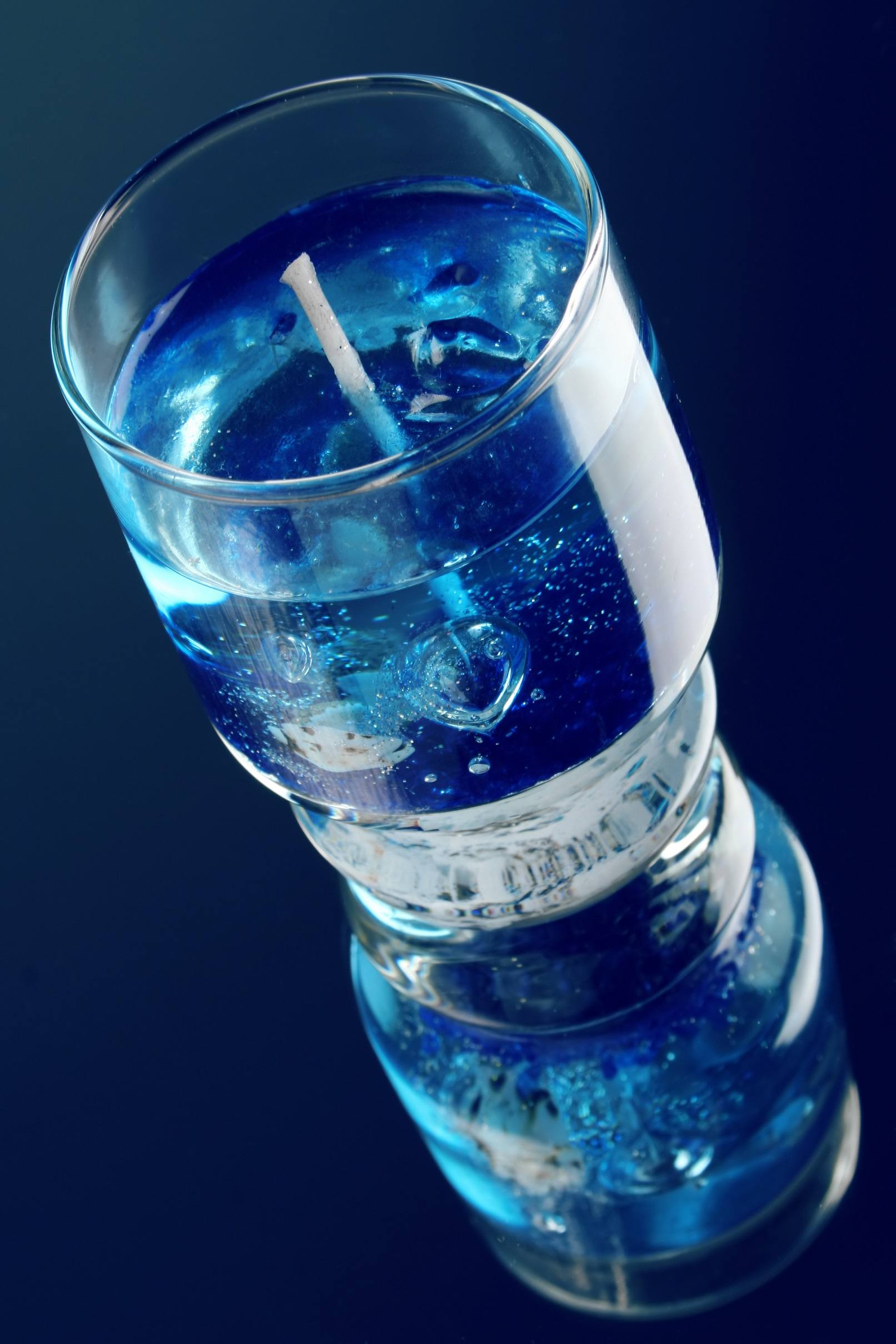 Gel candle on blue background