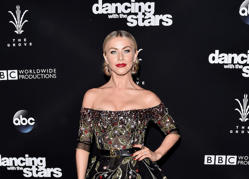 Julianne Hough poses with his hand on his hip