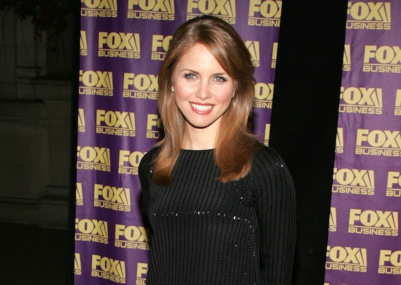 Jenna Lee smiles and poses in a black dress
