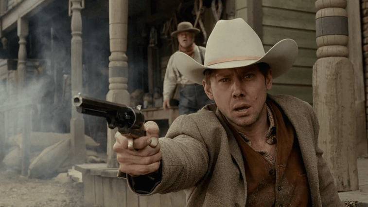 Jimmi Simpson as William firing a gun in Westworld