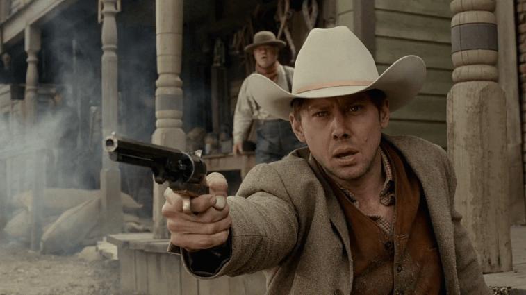 Jimmi Simpson as William firing a gun in Westworld