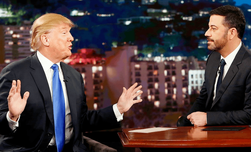 Donald Trump lifts his hands while talking to Jimmy Kimmel