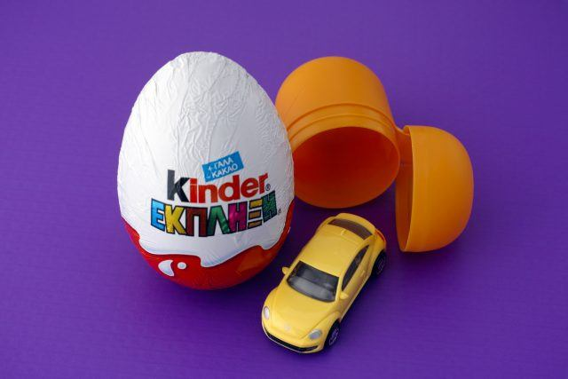 Kinder Surprise egg on purple background.
