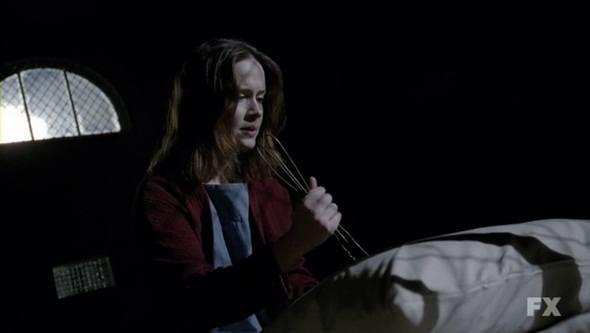 Lana holding a coat hanger in American Horror Story: Asylum