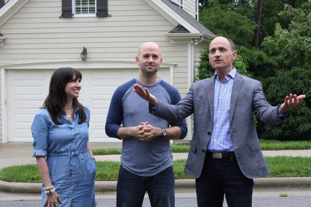 A couple being shown a house.